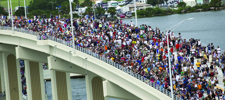 Citizens watching a shuttle launch from the Max Brewer Bridge.